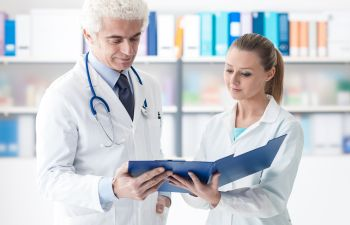 Doctor Reviewing Files